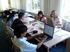 Students Sitting at Conference Table
