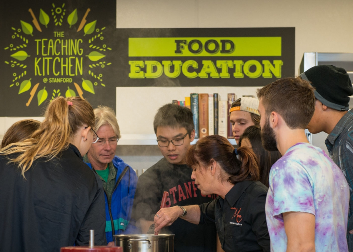 Students participate in a the Farm to Fork Cooking Series at the Teaching Kitchen @ Stanford
