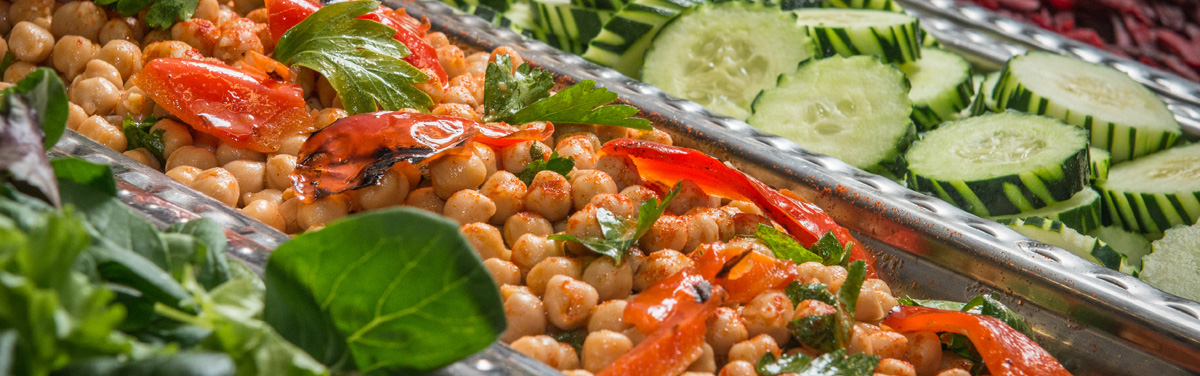 Salad bar with chick peas and cucumbers