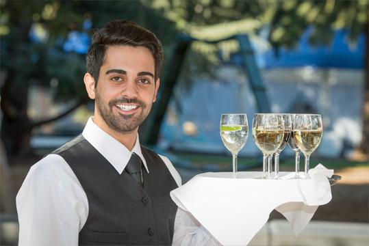 Waiter holding glasses of champagne
