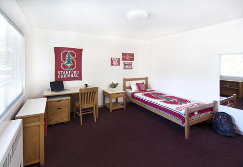 Dorm room decorated with Stanford items
