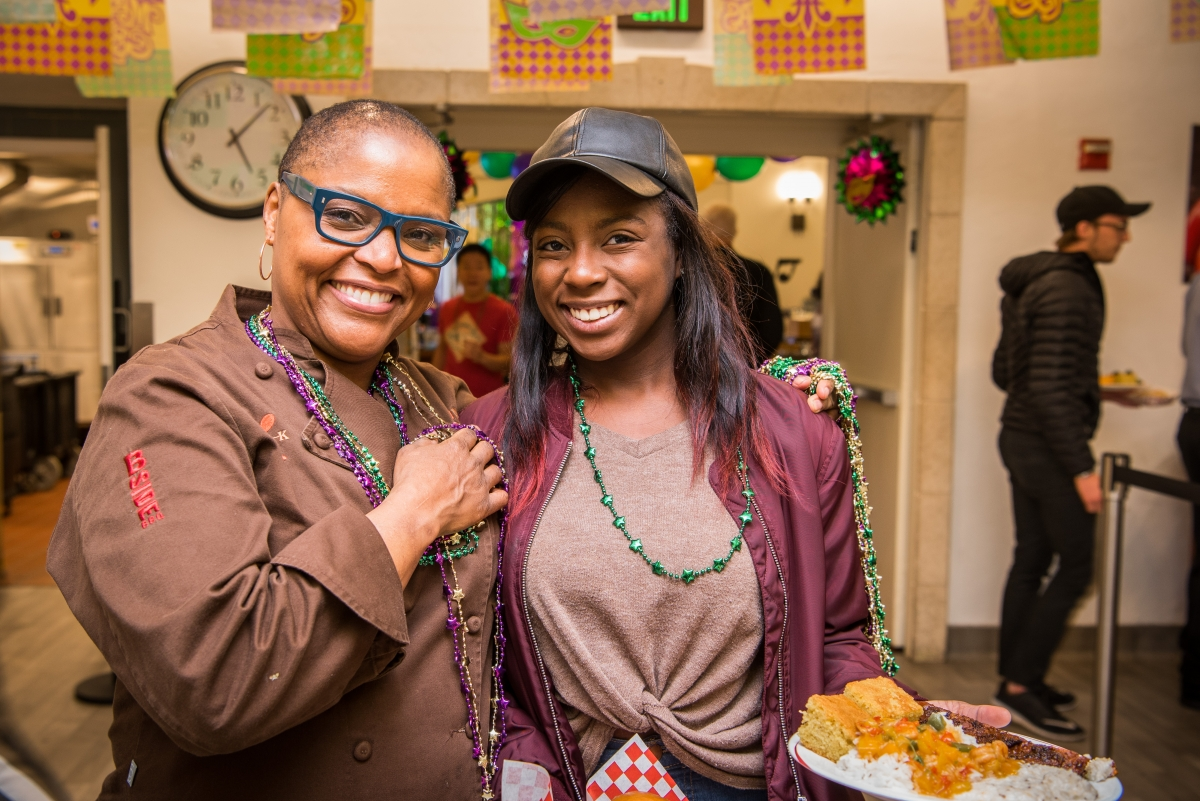 Chef Tanya Holland with student at Mardi Gras