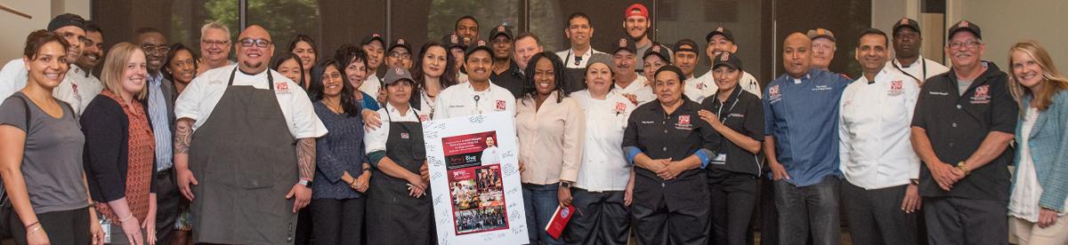 Rafael Velasquez celebrates his Amy J. Blue award with R&DE Stanford Dining
