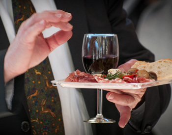 An antipasto platter and a glass of red wine