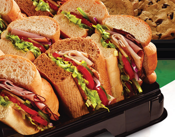 Subway catering tray with delicious sub sandwiches and fresh cookies