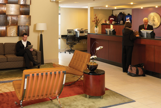 A guest being helped at the front desk of the Stanford Guest House.