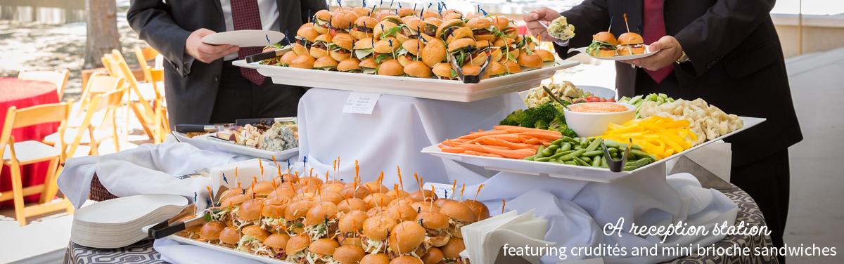 A reception station featuring crudites and mini brioche sandwiches