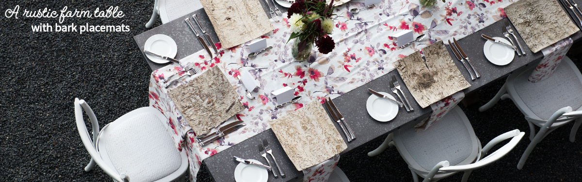 A rustic farm table with bark placemats