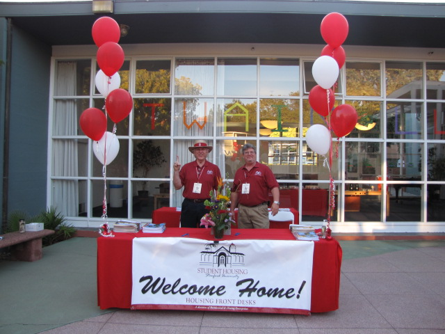 Welcome Home table outside a residence hall