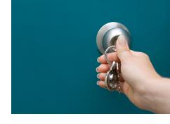 photo of key in door knob