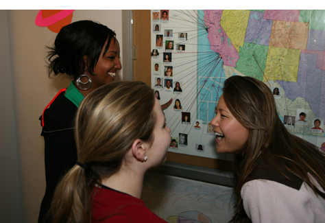 Three students looking at a map