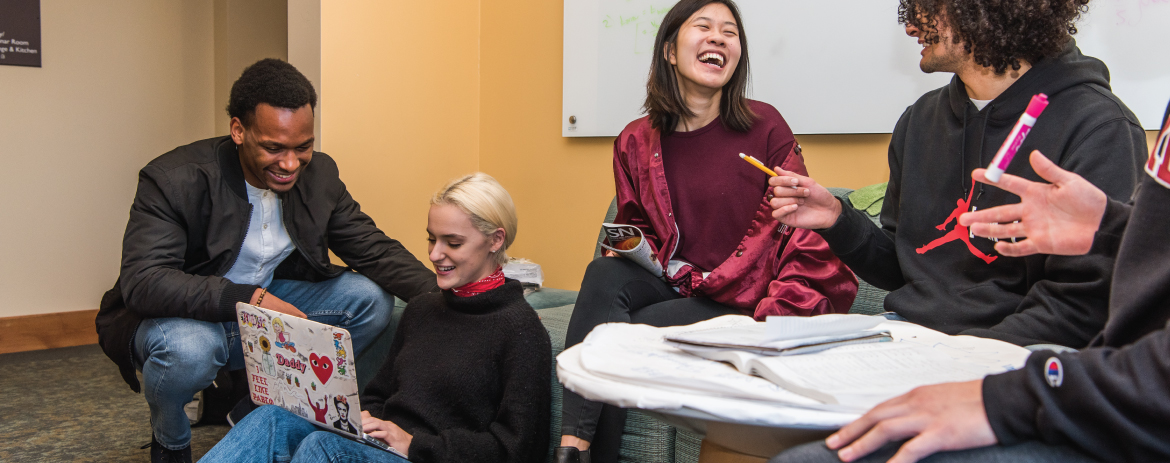 students gather in the huddle spaces