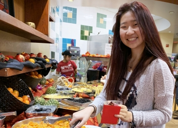 Bessie Zhang, '24, samples the selection of dried fruits