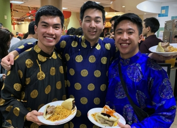 students sample the cuisine before performing at Lunar New Year