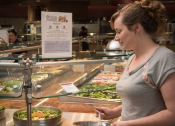 Diner perusing food in Arrillaga Family Dining Commons