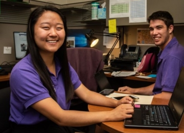 Two SC student team members at work