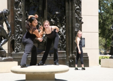 Students in US Performing Arts (USPA) performing near Rodin Sculptures